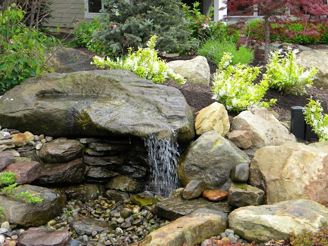 Carved stone waterfeatures falling waters ohio llc