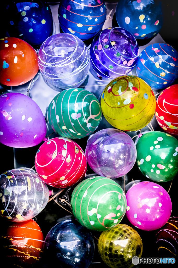 Japanese water balloons aka yo-yos. They come on a rubber string and have a bit of water in them so they can go up and down (hence the yo-yo).