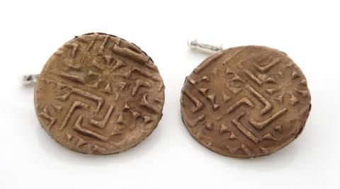 Bronze and silver cufflinks with the pattern taken from a Victorian ceramic tile.