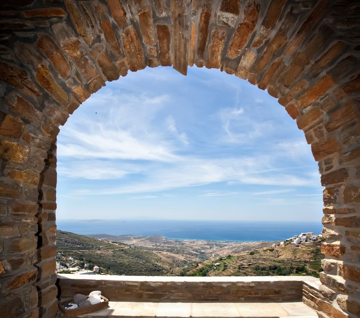 Through your window, a 360 degree view. The open horizon embraces eleven Cycladic islands! You are on the 'Caldera' of Tinos!