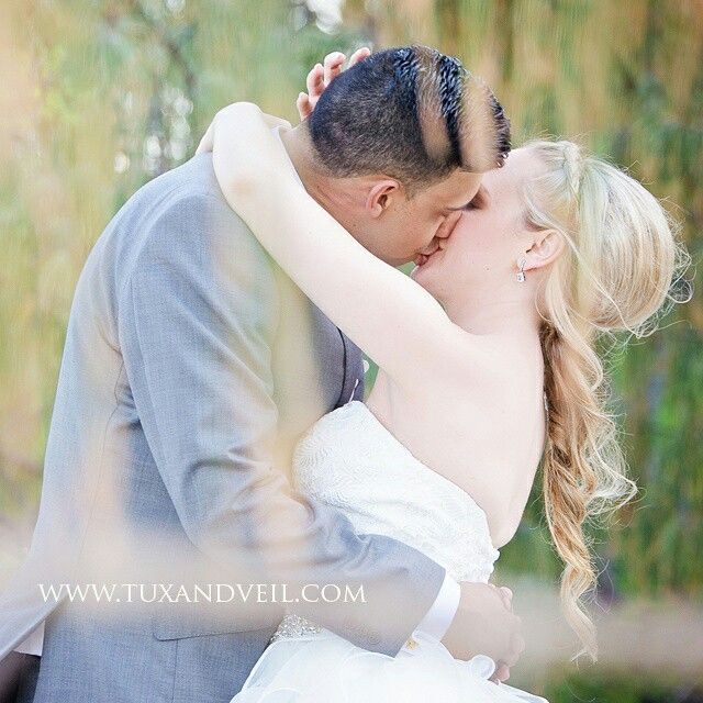 Beautiful unique wedding photography. Love the foreground bokeh Bride and groom wedding photo beach wedding