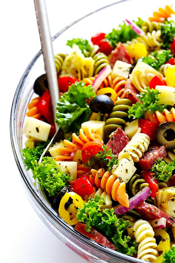 This Rainbow Antipasto Pasta Salad is the perfect way to use up leftover antipasto ingredients! Plus, it's easy to make, tossed with a zesty Italian herb vinaigrette, and absolutely delicious!   gimmesomeoven.com