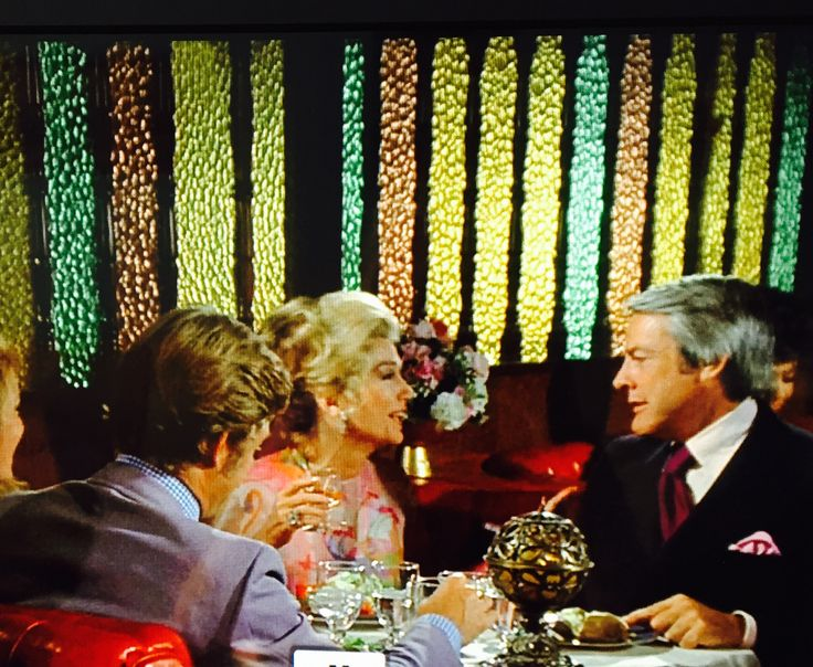 Screen shot of Columbo. I adore the partition behind them!