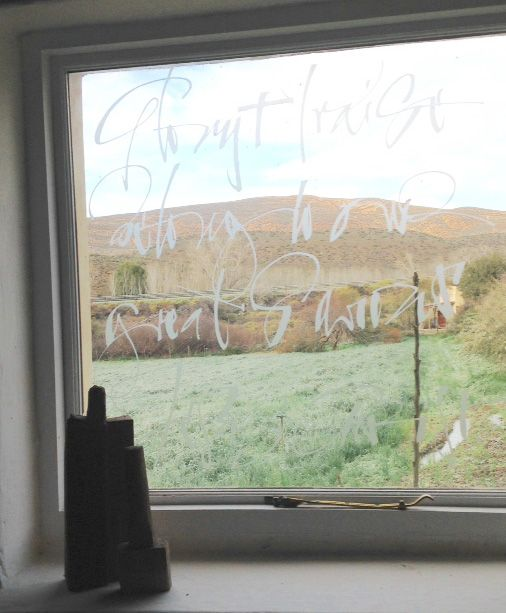 Calligraphic window by Heleen de Haas at the Letterhuis Guest Farm