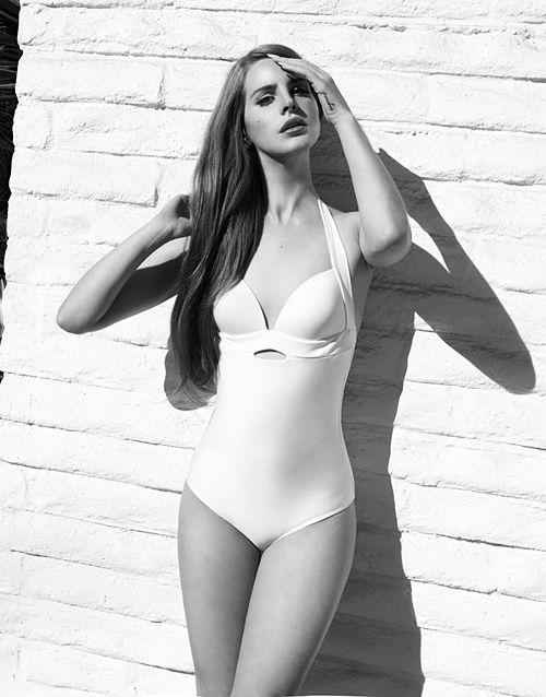 Lana Del Rey in a pretty, white swimsuit