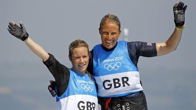 Britain's Hannah Mills and Saskia Clark celebrate as they cross the finish line to win silver in the women's 470 sailing class at the London 2012 Olympic Games in Weymouth and Portland