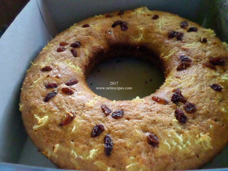 Banana cake with dry raisins and cheese topping.