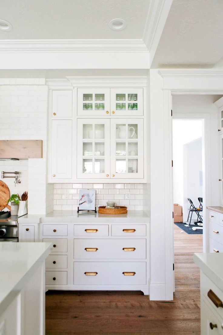 All-White Eat-In Kitchen With Black Cone Pendant Lights