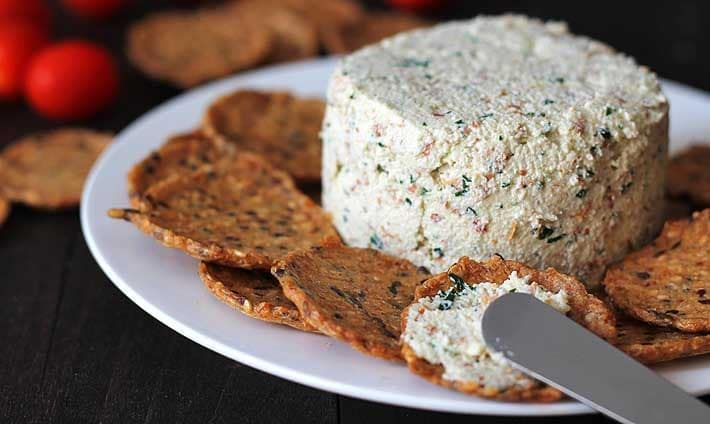 Garlic herb vegan almond cheese spread that's bursting with flavour and can be used in many ways. It's great on crackers, sandwiches, as a veggie dip, and more!