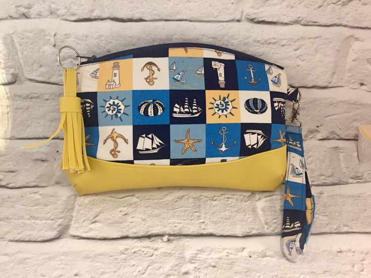 A personal favourite from my Etsy shop https://www.etsy.com/uk/listing/544237393/nautical-clutch-purse-with-strap-small