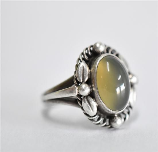 Buy online, view images and see past prices for A RARE GEORG JENSEN CATS EYE RING, central cabochon cut Cats eye chrysoberyl of 12.3 x 8mm, all set in sterling silver, designed by.... Invaluable is the world's largest marketplace for art, antiques, and collectibles.