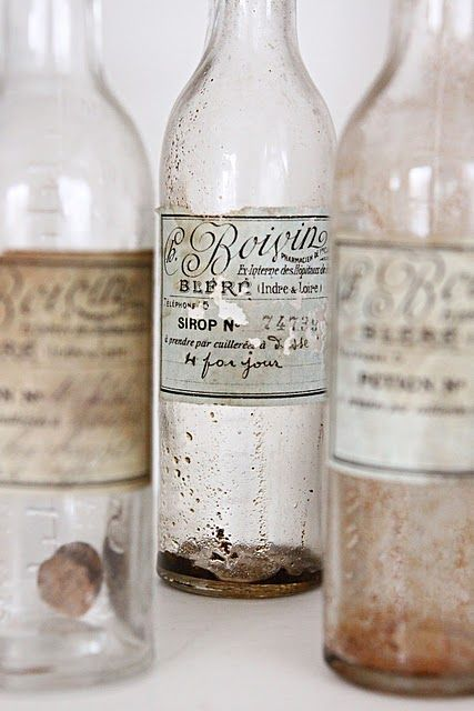 antique bottles and muted colors - might be fun for centerpieces. we can do the labels.