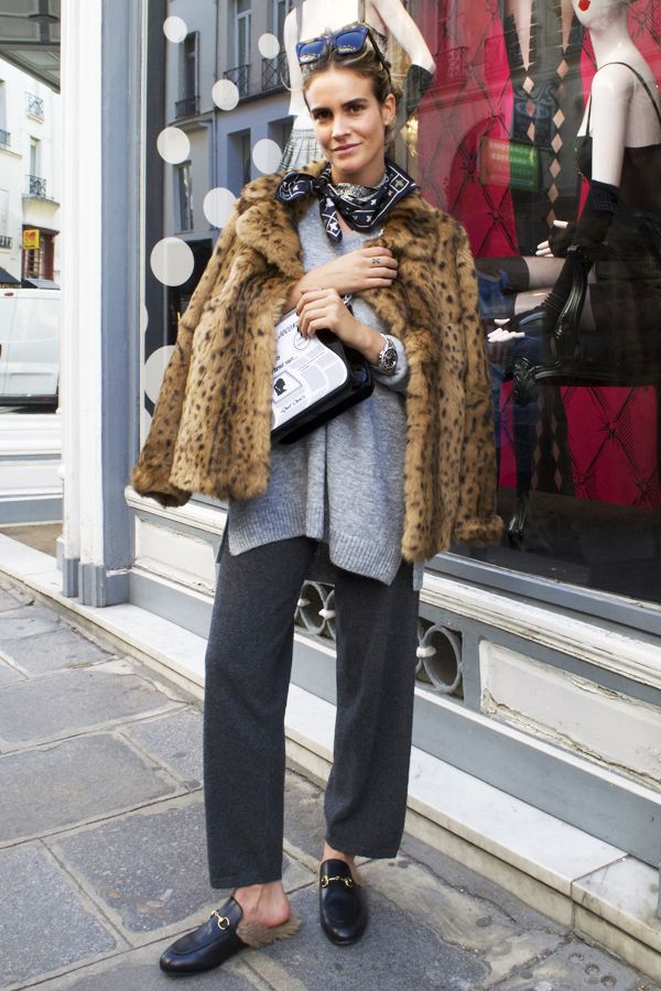 Leopard fur, neutral pants and sweater, Gucci loafers, good accessories.