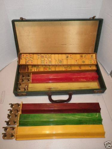 Acquired at an estate sale is this vintage mahjong set in its original case.  The clasps on the case work.  The case appears to be a green alligator style pattern – not sure of the material.