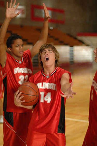 "That time he felt like just holding the basketball and belting out a note and Zeke the Baker looked confused. | 27 Times Zac Efron Embarrassed Himself In The ""High School Musical"" Franchise"