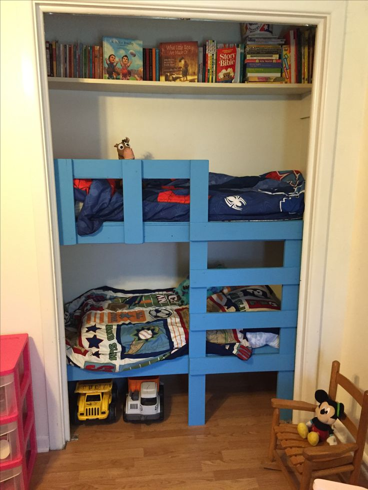 Toddler Bunk Beds in a closet. This leaves so much space in the boys room!!!