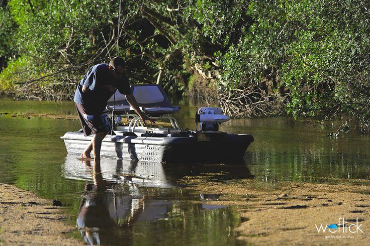 Bass Hunter Fishing up River.