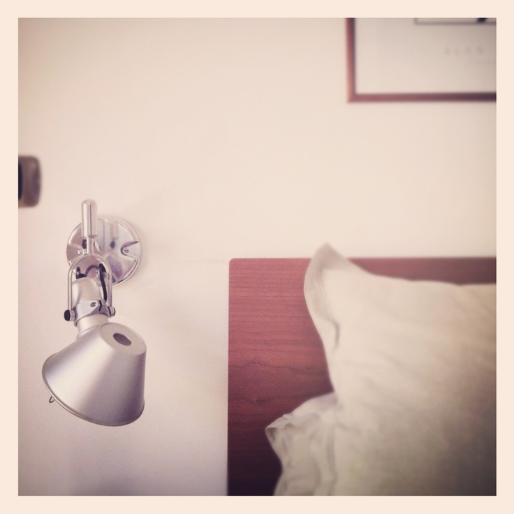 Tolomeo lamp by Artemide in our messy saturday morning bedroom {my iPhone}