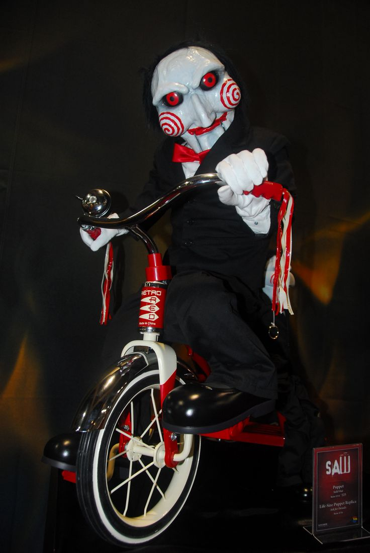 "Single most scary moment in a movie theater EVER. Jigsaw from ""Saw"" when he wheeled in on that tricycle!! OMG I screamed so loud!"