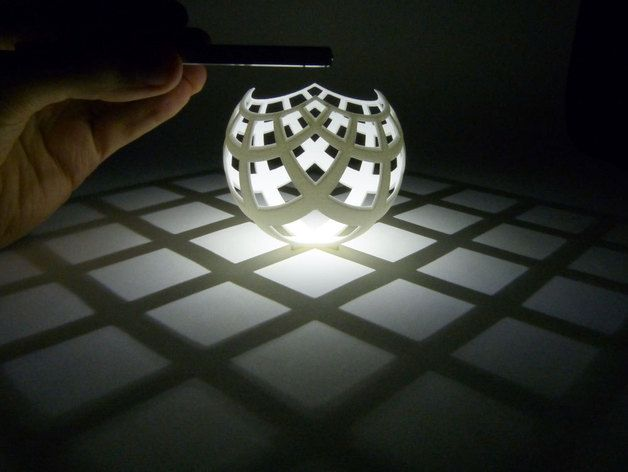 Stereographic Projection Lampshade by henryseg  [ http://thingiverse.com/thing:202774 ] If you put a light source at the north pole of this sculpture, the rays of light effectively do stereographic projection! The curves on the sphere cast shadows, mapping them to a straight line grid on the plane.