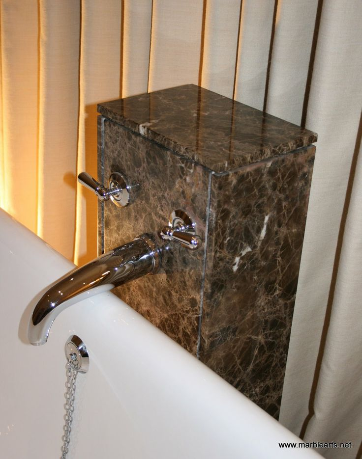 Marble hydrant for free standing bath in North Yorkshire. Marble is Maron Imperial.