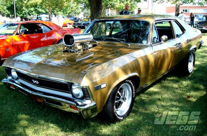 A Chevy Nova SS Resting Under The Trees At A Local Car Show...  Should Engines Stay Under The Hood Or Be Allowed To Stick Out?