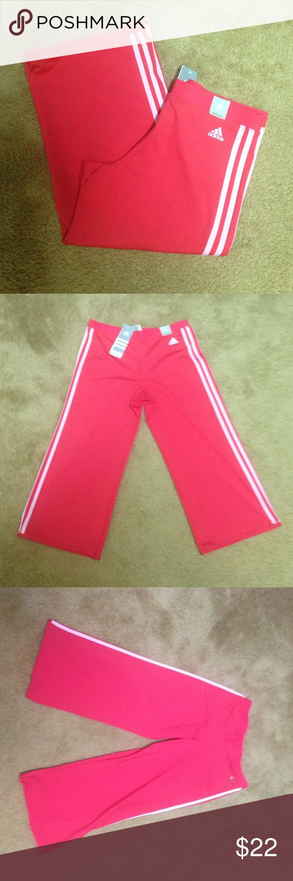 Adidas new coral capris Adidas new pink with white stripe down sides.  Brand new with tags never worn.  No pockets.  Slim fit. Adidas Pants Capris