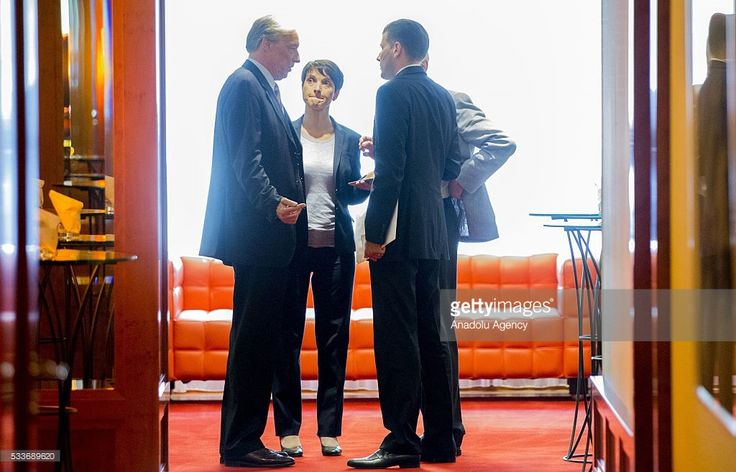 Head of the right-leaning populist Alternative fuer Deutschland (Alternative for Germany, AfD) political party Frauke Petry (C) is seen after the Secretary General of the Central Committee of Muslims in Germany (ZMD), Nurhan Soykan (not seen) meeting in Berlin, Germany on May 23, 2016.