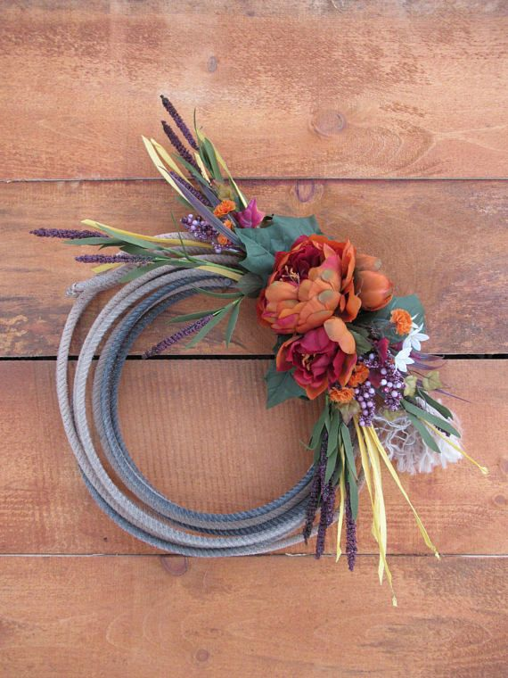 Add a touch of western style to your home with this beautiful rope wreath! . Made with high-quality ropes used by real cowboys and cowgirls from Texas! Don't let your guests miss out on seeing this lovely wreath the next time they knock on your door. Pretty for a Spring Door Accent!