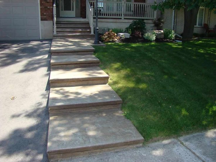 Decorative coloured, stamped concrete sidewalk and steps add curb appeal to this home.