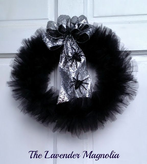 black tulle halloween wreath with silver webbing bow and black glitter spiders