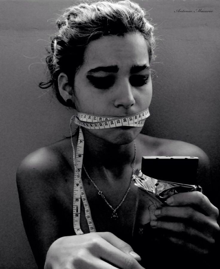 Battling eating disorders This photo really speaks to me as someone in need of help I love how the photographer has set out the content of it and I think by having it in black and white it stands out to show upset, hurt and the struggle this person faces.