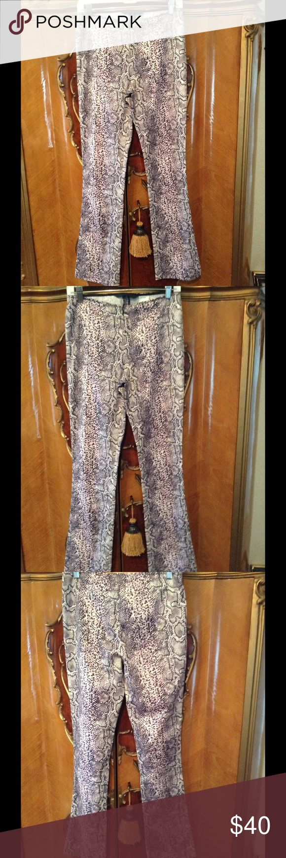 "Adorable Guess Collection Snake Print Pants Absolutely adorable snake print pants and black white and the pill list shade of pink ever, front seat of the black zipper, absolutely beautiful, pristine condition.  32"" inseam. Guess Collection Pants"