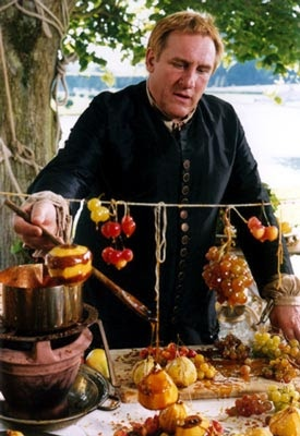 VATEL, the true story of the French kitchen (and culinary) master who delighted Kings but never at the cost of honor. Stunningly beautiful and insightful beyond words. http://en.wikipedia.org/wiki/Vatel_(film)
