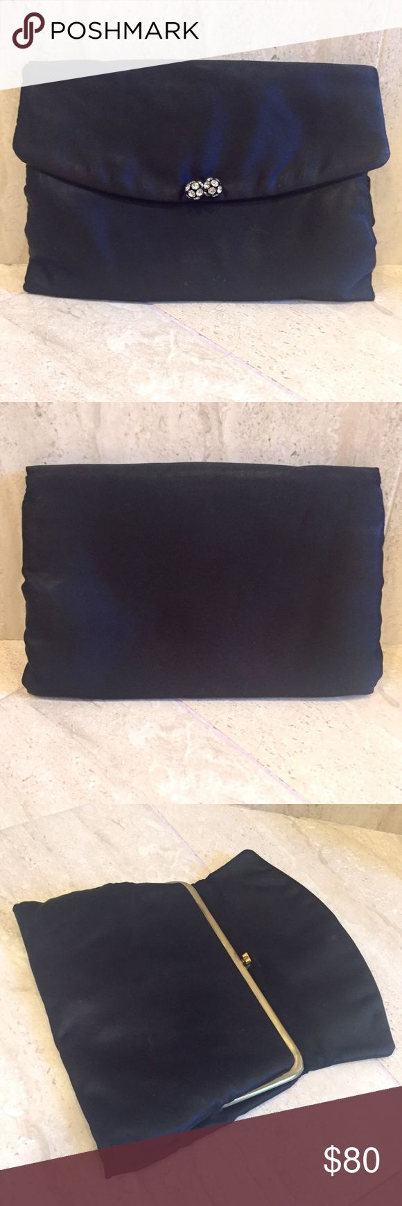 """Satin Formal Clutch This satin black clutch is a gorgeous addition to your formal attire. Two simple crystal ball shape additions to the front make it a very classy look. Inside there's a mini coin purse attached. Great condition.  9"""" long at bottom and 8"""" at top. Height is about 6"""". Bags Clutches & Wristlets"""