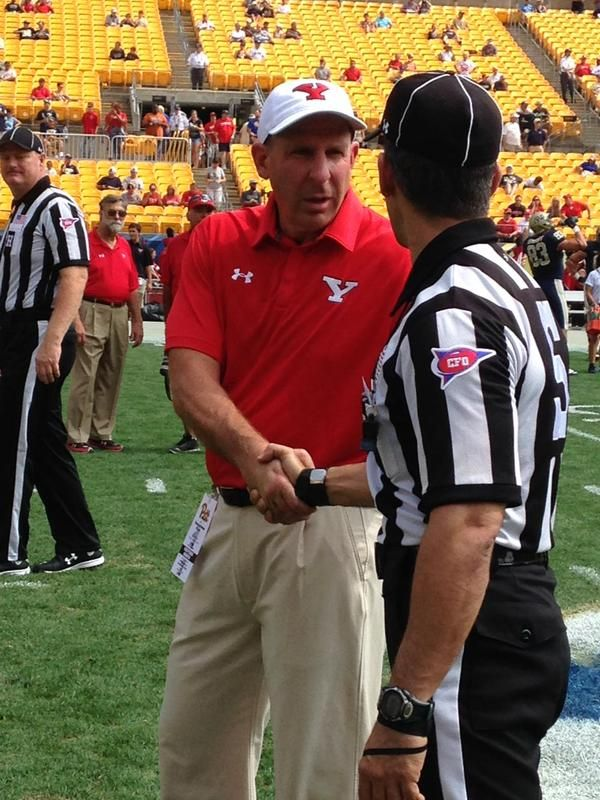 YSU Coach Bo Pelini shaking hands with an official at Heinz Field prior to the start of the YSU vs Pitt game.