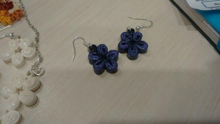 Really small malaysian flower earrings.