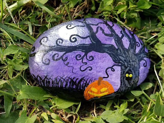 Purple Halloween painted rock with curly tree moon and