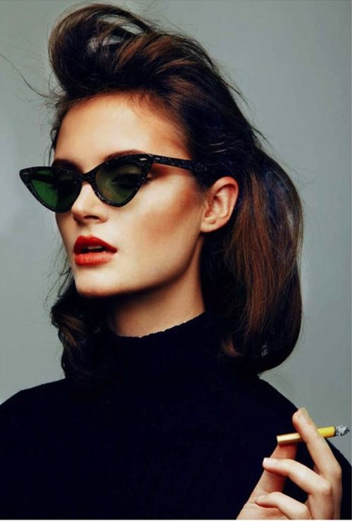 Black Turtle Neck + cat wing glasses + coiff + red lippy
