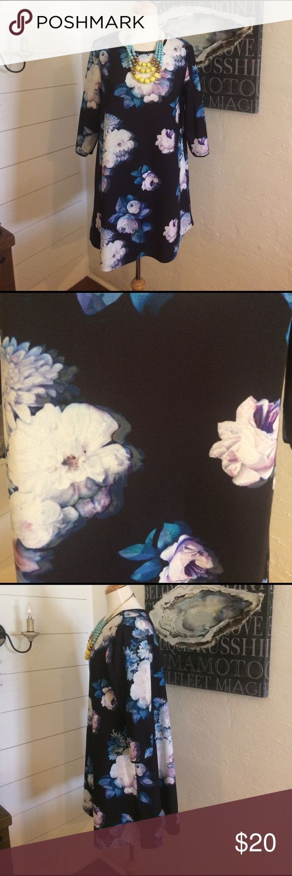 River Island Floral Swing Dress River Island Floral Swing Dress in black with purple, white & blue florals, 3/4 sleeves. This runs smaller but still flowy & swingy! Super cute with heels or casual with boots & leggings. Worn once! River Island Dresses