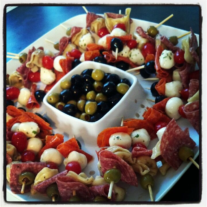 Antipasto skewers from a pin I recently repined... olives, salami, 3 cheese tortellini, pepperoni, mozzarella balls.