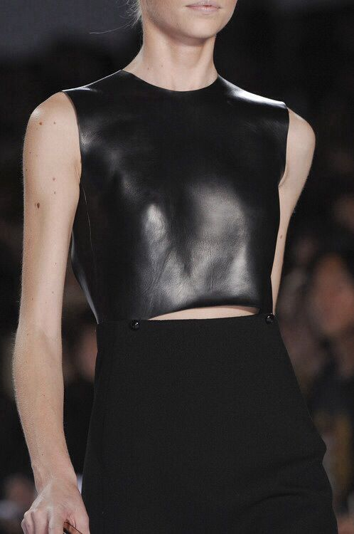 Structured Simplicity - dress in contrasting black fabrics and understated pin stud detail