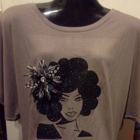 Black Glitter Tee flower shown not included,  we can include a flower with your order but it will not be same as the one shown. Or you can purcase a flower from your local beauty supply store to coordinate with your outfit.