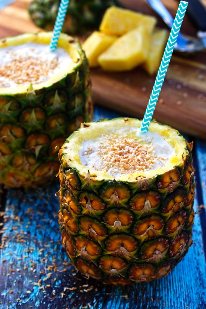 Piña Colada On the Rocks and in a Pineapple | http://cookswithcocktails.com/pina-colada-cocktail-in-a-pineapple/