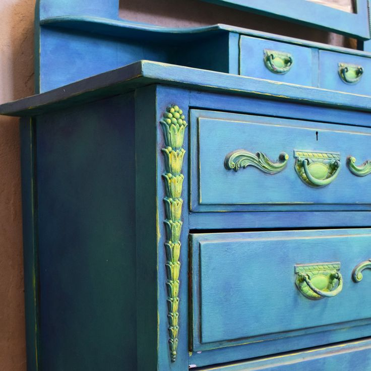 Gorgeous vanity dresser by Annie Sloan Stockist Interiors to Inspire in Calgary, Canada! Inspired by ocean colors, the piece had Chalk Paint® colors blended right on the surface. Florence, Napoleonic Blue, and Antibes Green were used with accents of English Yellow and Graphite.