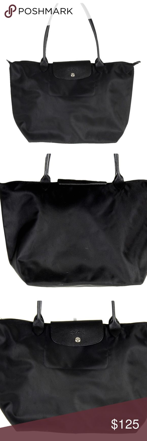 """Longchamp Le Pliage Neo Black Foldable Tote Large Longchamp Le Pliage Neo  LargeTote  Top zip with logo-stamped snap-flap tab closure. Interior cell-phone pocket. Water-resistant lining. Nylon with leather trim. 13""""W x 12""""H x 7 ¾""""D. 8 ½"""" strap drop.  Floor Model Pictures of the actual bag and not stock photos.  •Purchased from a high end US Retailer. Floor Model.  Might be marks in the finish from being on display. Longchamp Bags Totes"""
