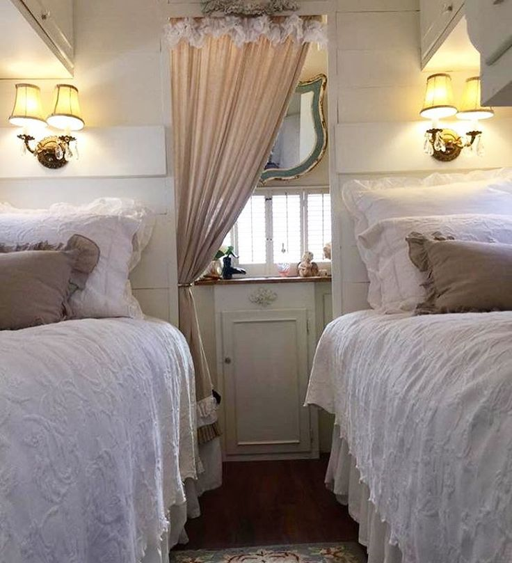 twin bed set up in vintage Streamline Duke trailer.
