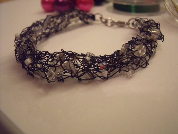 Black knitted wire bracelet with white beads by ChickFromLeeds