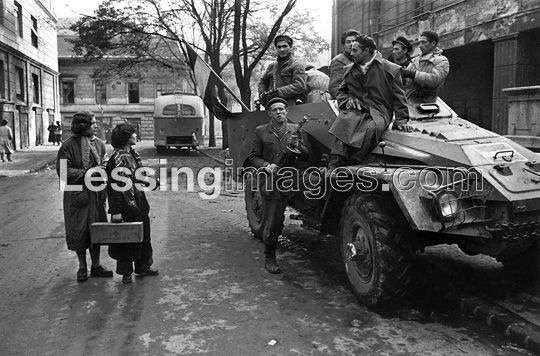 The Hungarian Revolution began with a first mass-rally in Budapest on October 23,1956.It was crushed by Soviet tanks and artillery after days of street-fighting. Large parts of the Hungarian army went over to the insurgents;revolutionaries riding an armoured car.
