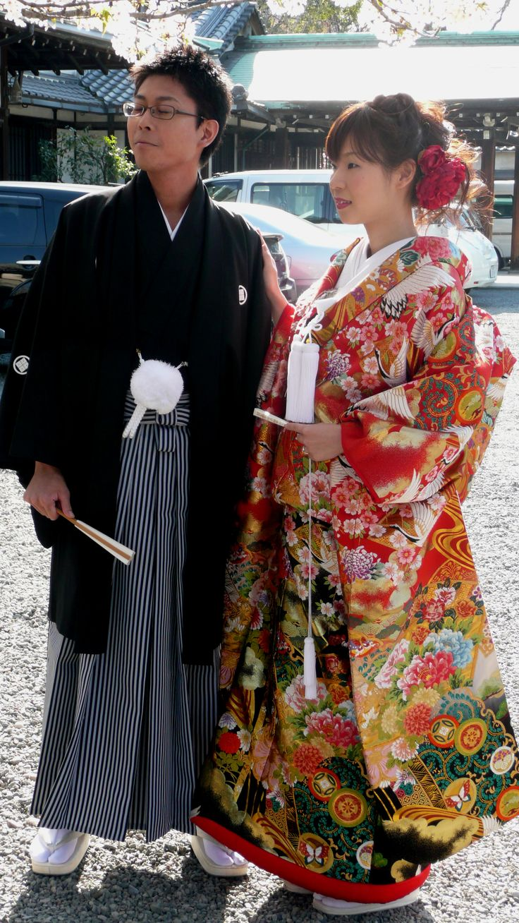 The groom wears MONTSUKI and the bride wears UCHIKAKE. UCHIKAKE is a highly formal kimono that is currently worn by a bride or at a stage performance. It is supposed to be worn outside the actual kimono (called kakeshita or kosode) and obi (sash), as a sort of coat, and never ties the obi around the UCHIKAKE.